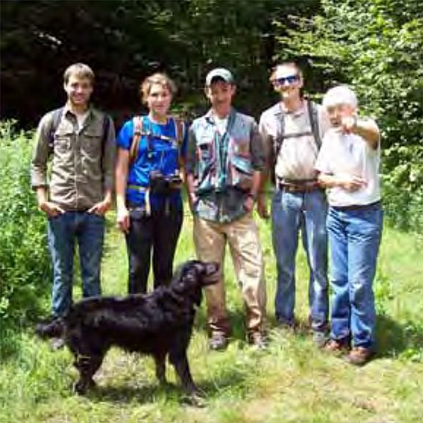 Photo of a group of people with a dog